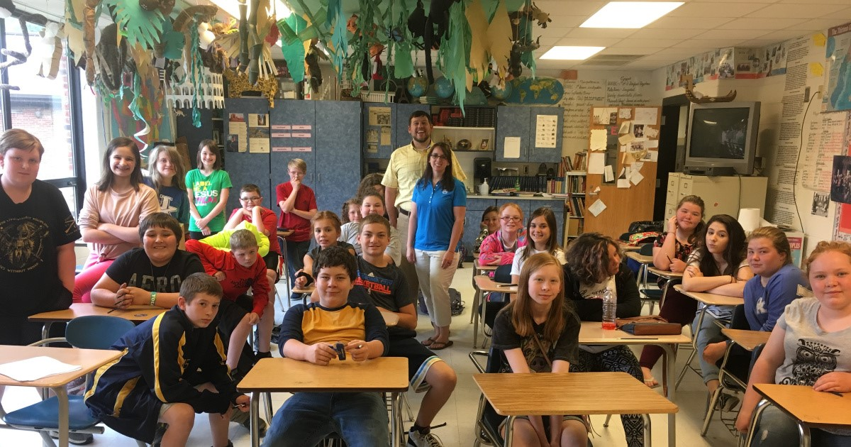 Harlan County Women's Chair Lindsey Boggs and Young Farmer Chair Nathan Boggs teach 5th graders