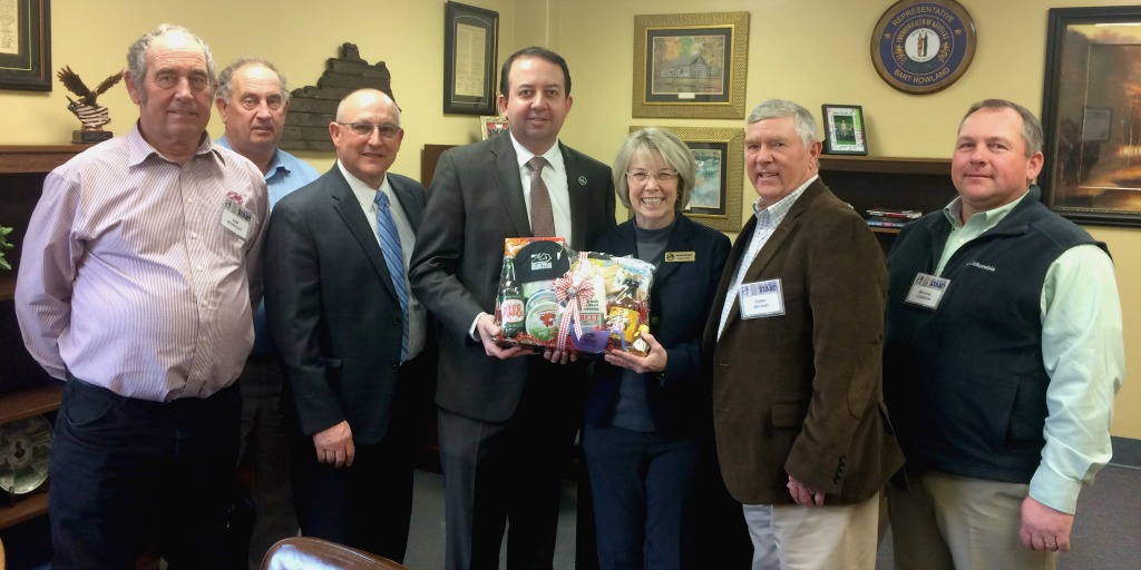 Members from Hart and Monroe counties present KY Representative Bart Rowland with a food basket.