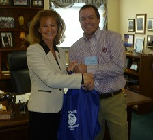 State Rep. Martha Jane King receives a food basket of KY food products from Logan County Farm Bureau President Jeremy Robertson.