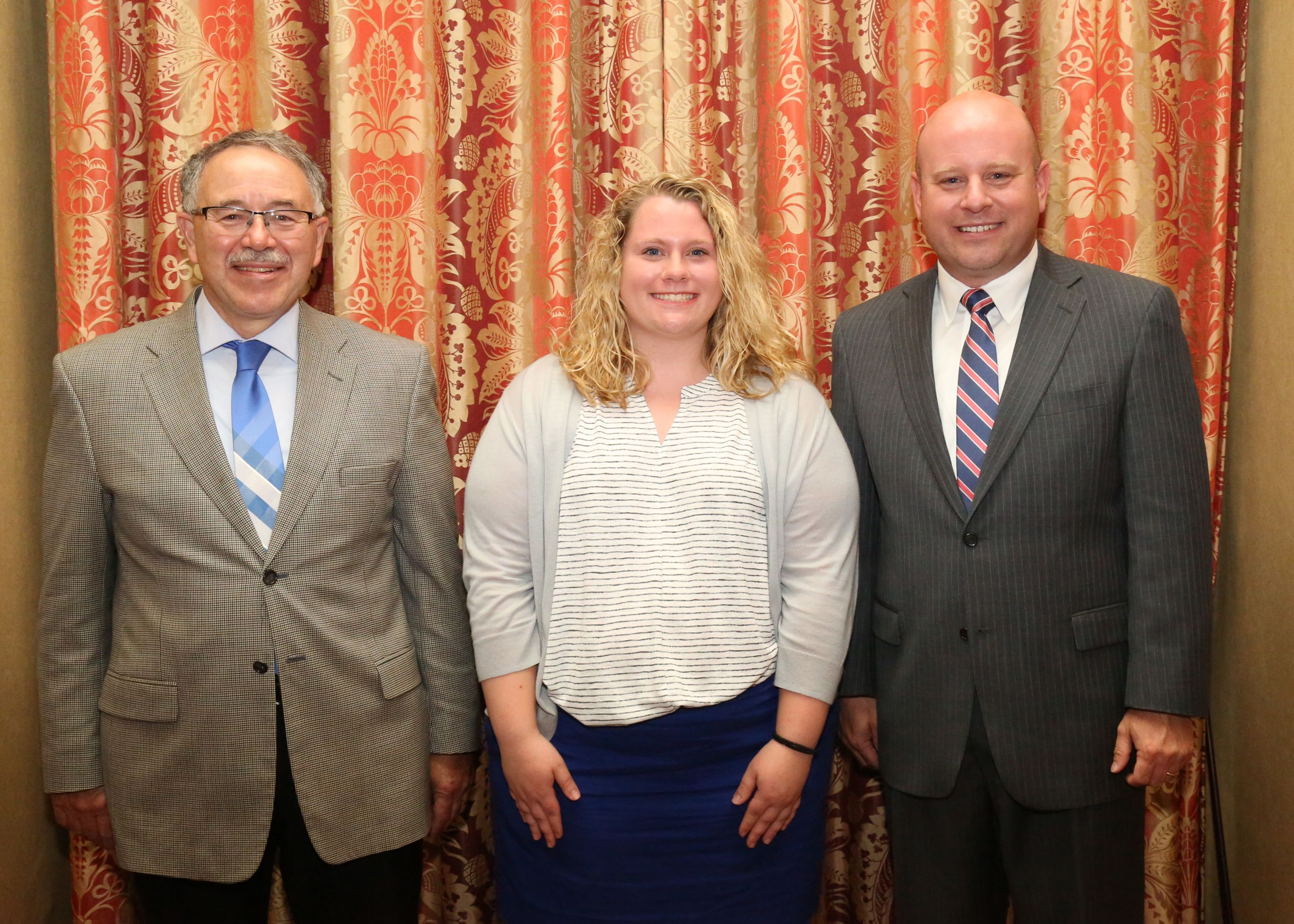 Katie French (center) is pictured with Dr. Larry Grabau, Associate Dean for the University of Kentucky College of Agriculture, Food & Environment (left) and Matthew Ingram, Assistant to the Executive Vice President and Director, Organization Division, Kentucky Farm Bureau (right), during the 2018 Institute for Future Agricultural Leaders (IFAL) at the University of Kentucky