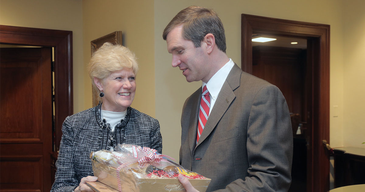 KFB Women's Advisory Committee Chair Judy Hayden gives Kentucky Governor Andy Beshear a basket of Kentucky Proud agriculture products during KFB Legislative Drive-In and Food Check-Out Day