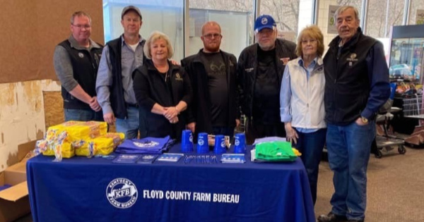 Floyd County Farm Bureau President Saul Akers, Vice President Billy Hicks, Women's Chair Sherry Akers, Young Farmer Chris Akers, Board member Charles Hackworth, Women's Committee Member Elmina Hackworth and Insurance Agent Manager Brian Pugh held the FCFB Food Check-Out Day in Prestonsburg, KY.