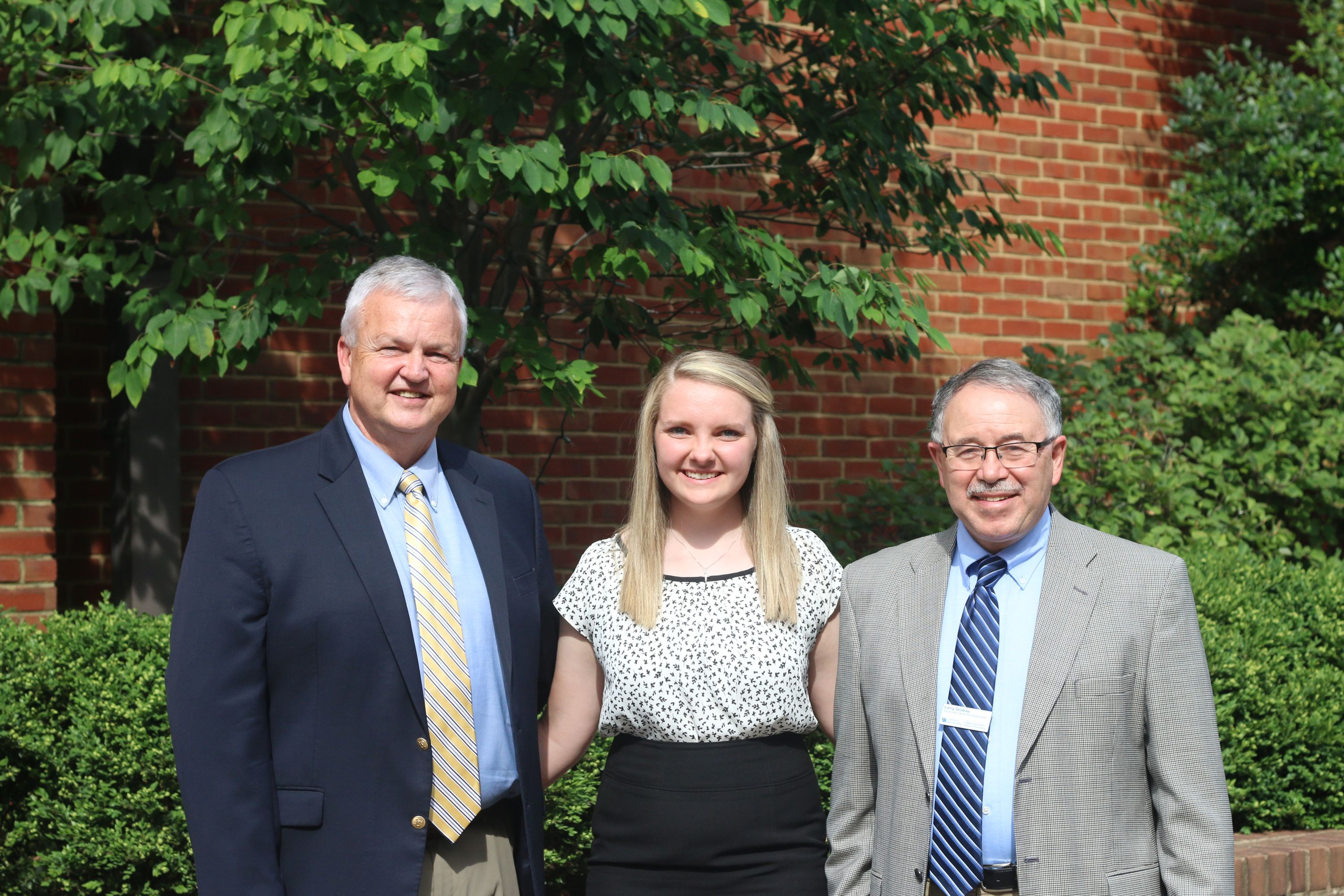 Clarissa Mackey (center) is greeted by Joe Cain, Kentucky Farm Bureau Director of Commodities (left), and Dr. Larry Grabau, Associate Dean for Academic Programs of the University of Kentucky College of Agriculture, Food and Environment (right), during the 2017 Institute for Future Agricultural Leaders (IFAL).