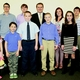 Commissioner Comer congratulates poster and essay contest winners