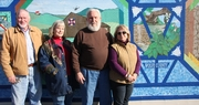 The right image . . .mural at Wolfe County Farm Bureau office honors rural culture