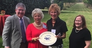 Steve Wilson and Laura Lee Brown receive the 'Linda Bruckheimer Excellence in Rural Preservation Award' from Preservation Kentucky